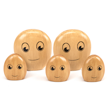 The Wooden Pebble Family  medium